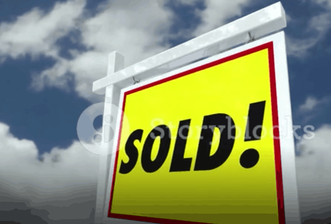"""Picture of a """" sold"""" sign on a post"""