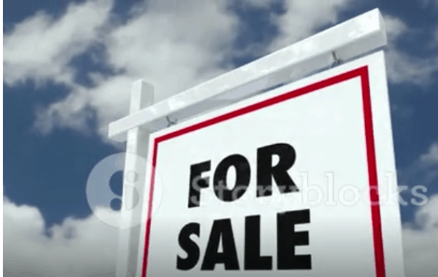 """Picture of a """"for sale"""" sign on a post"""